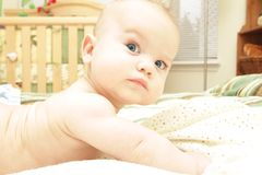 Baby Boy on Bed, Naked. In his nursery room Stock Photos