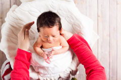 Baby boy being cared for by his mother. Baby boy in a basket being cared for by his mother Royalty Free Stock Photography