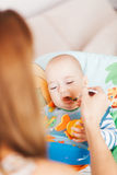 Baby boy being fed. With a spoon royalty free stock photo