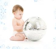 Baby boy with big disco ball. Adorable baby boy with big disco ball Stock Image