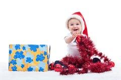 Baby boy with big present Stock Photo