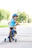 Baby boy on bike. With crash helmet Royalty Free Stock Image