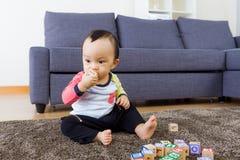 Baby boy bite toy block Royalty Free Stock Photography