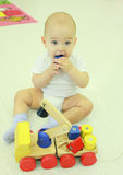 Baby boy biting a toy. Royalty Free Stock Images