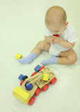 Baby boy biting a toy. Stock Photography