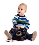 Baby boy with black vintage phone Stock Image