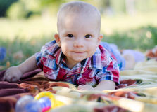 Baby boy on Blankets. Cute baby boy lying on his stomach on the Fleece in the park stock photo