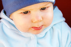 Baby boy in blue. Adorable 8 months old baby boy Stock Images