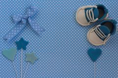 Baby shower invitation. Newborn background. Baby boy blue card. Newborn background. Baby shower invitation.Baby announcement. Fondant baby accesories. Flat lay Stock Photography