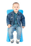 Baby boy on blue chair Royalty Free Stock Photos