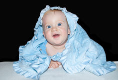 Baby boy blue eyes. Baby boy with blue eyes in blue clothes smiles Royalty Free Stock Images