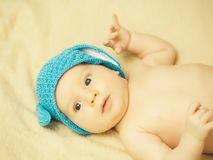Baby boy with blue hat stock photography