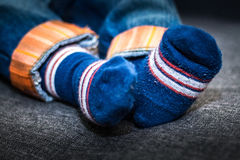 Baby boy blue jeans with blue socks Stock Image
