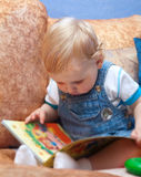 Baby boy with book Stock Images