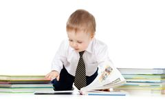 Baby boy with books over white Royalty Free Stock Image