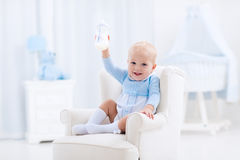 Baby boy with bottle drinking milk or formula Royalty Free Stock Photos