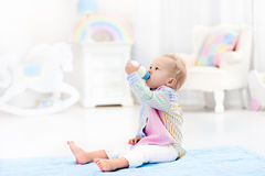 Baby boy with bottle drinking milk or formula Royalty Free Stock Images