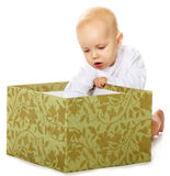 Baby boy with box Stock Photos