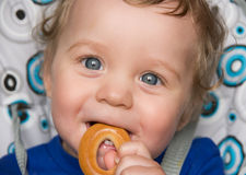 Baby boy with bread ring Stock Photography