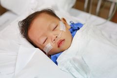 Baby boy with breathing tube in nose receiving medical treatment. Intensive care at hospital.  royalty free stock images