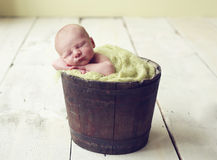 Baby boy in a bucket Stock Image