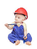 Baby boy in a builder dress Stock Image
