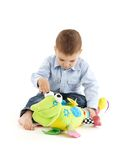 Baby boy busy playing Stock Image