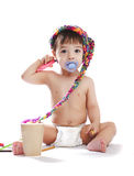 Baby boy in a cap with felt pen Royalty Free Stock Photos