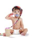 Baby boy in a cap with felt pen Royalty Free Stock Photos