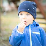Baby boy with cap at Park stock photography