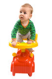Baby-boy in a car. Baby-boy sitting in a baby's car isolated on white background Stock Photos