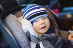 Baby boy in car seat. In winter time Royalty Free Stock Image