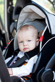 Baby boy in car seat. Cute little boy in car seat Royalty Free Stock Images