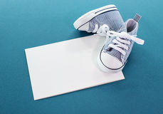 Baby boy card with small sport shoes Stock Photo
