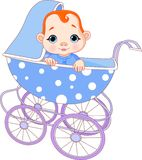 Baby boy in carriage Stock Photo