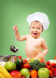 Baby boy in chef hat with cooking pan and vegetables. Baby boy in chef hat with cooking pan and raw vegetables Stock Images