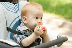 Baby boy chewing on toy Royalty Free Stock Photography