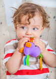 Baby boy chewing on toy Royalty Free Stock Photos