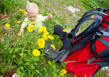 Baby boy with child carrier Royalty Free Stock Photos