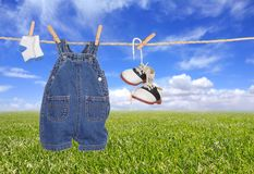 Baby Boy Child Clothes Hanging Outdoors Stock Photos