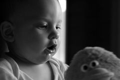Baby Boy Child Infant Toy Play. Black and white baby boy image Stock Image