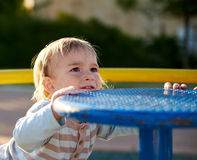 Baby boy child plays in playground area Royalty Free Stock Photo