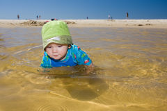 Baby boy child swimming in fun beach water Royalty Free Stock Photography