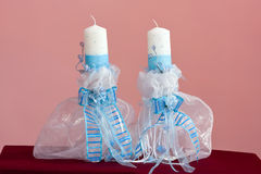 Baby boy christening blue and white candles Royalty Free Stock Photos