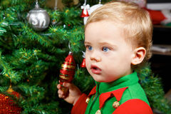 Baby boy on Christmas. 1 year old baby boy portrait by the Christmas tree Stock Photo