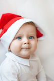 Baby boy with Christmas cap Royalty Free Stock Photography