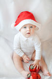 Baby boy with Christmas cap and balls Stock Photos