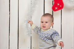 Baby boy with Christmas decorations Royalty Free Stock Photos
