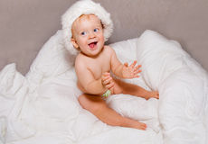 Baby boy in Christmas hat Stock Photography