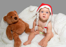 Baby boy in Christmas hat with Teddy bear Royalty Free Stock Photo